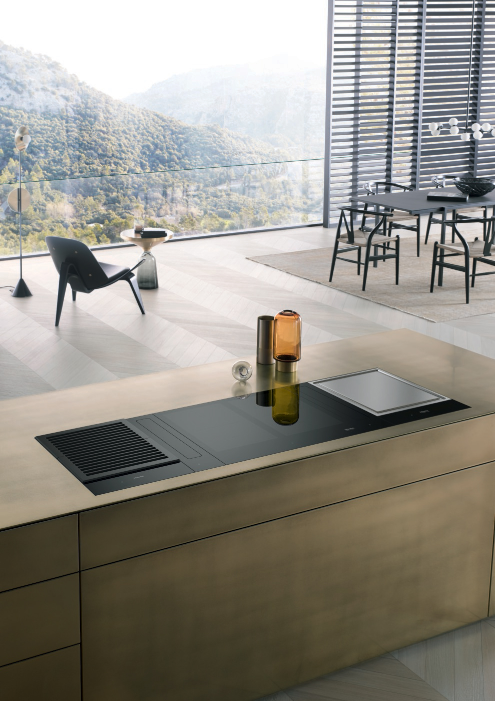 Domino de tables de cuisson : induction, TeppanYaki, grill et hotte intégrée de la série SmartLine de MIELE